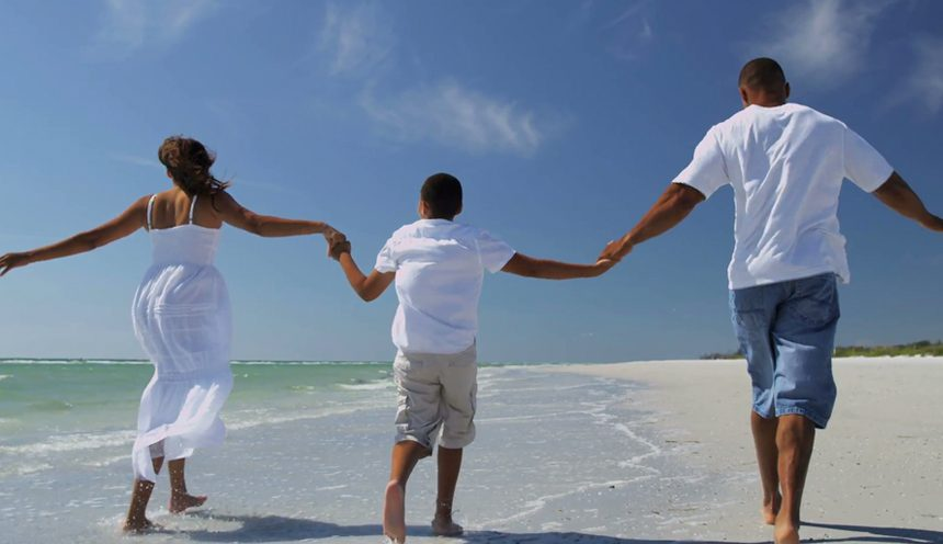family on coastal beach